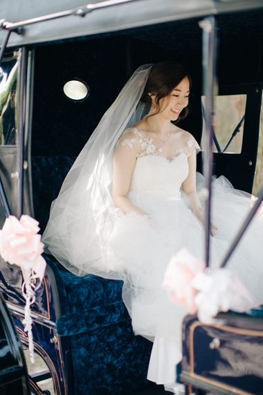Bride in Bespoke Princess Gown in Horse & Carriage | M and J Photography