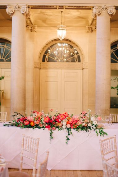Coral Top Table Floral Arrangement | Timeless Wedding Assembly Rooms in Bath | M and J Photography