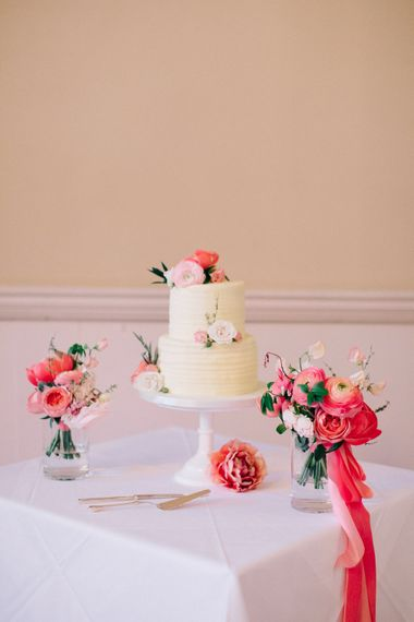 Two Tier Wedding Cake with Coral Peony & Ranunculus Floral Decor | M and J Photography