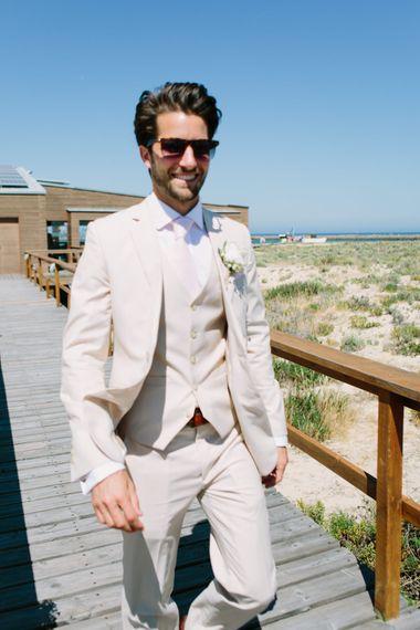 Groom in Beige Three Piece Wedding Suit | Jade Osborne Photography | The Amazing Rabbit Films