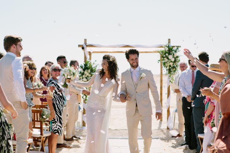 Beach Wedding Ceremony | Bride in Inbal Dror Wedding Dress | Groom in Beige Suit | Jade Osborne Photography | The Amazing Rabbit Films