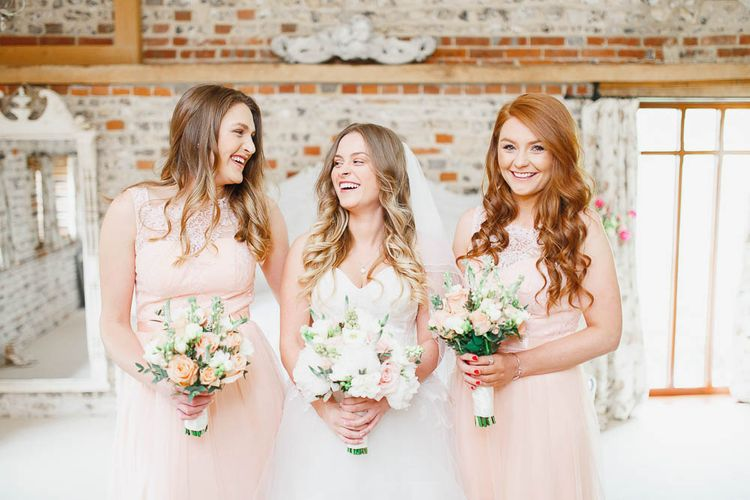 Peach Chi Chi Bridesmaid Dresses | Bride in Warren Watters Gown | White Stag Wedding Photography