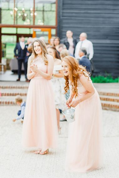 Bridesmaids in Peach Chi Chi London Dresses | Peach & White Wedding at Upwaltham Barns | White Stag Wedding Photography