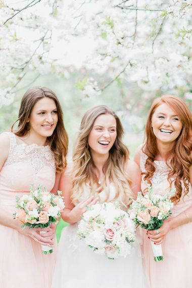 Bridesmaids in Peach Chi Chi London Dresses | Bride in Warren Watters Gown | Peach & White Wedding at Upwaltham Barns | White Stag Wedding Photography