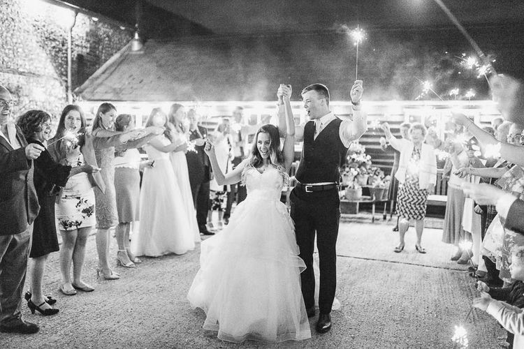 Sparkler Exit | Bride in Warren Watters Gown | Groom in Marks and Spencer Suit | Peach & White Wedding at Upwaltham Barns | White Stag Wedding Photography