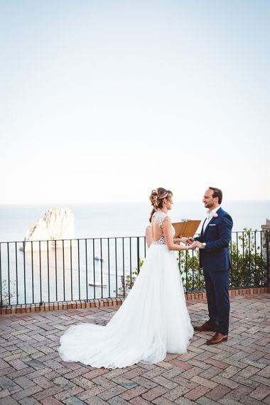 Wedding Ceremony | Bride in Calla Blanche Wedding Dress | Groom in Navy Hugo Boss Suit | Augustus Gardens, Capri Italy Destination Wedding | Paolo Ceritano Photography