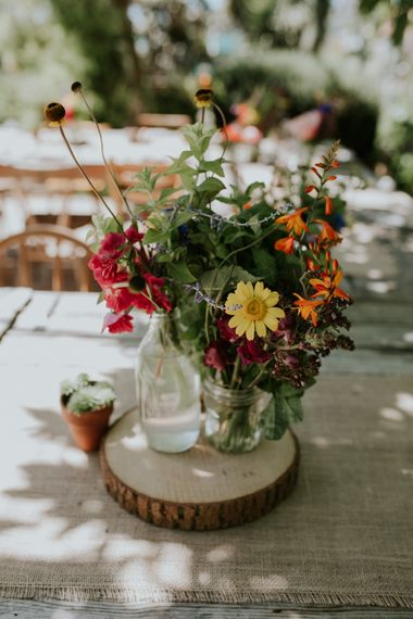 Floral Centrepieces With Wooden Log Slices