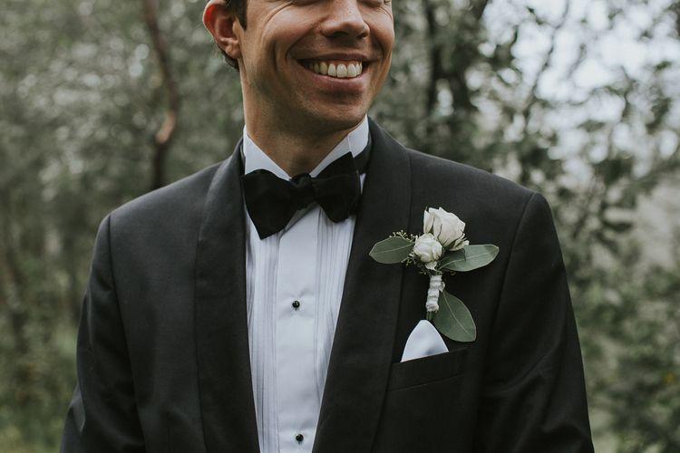 White Buttonhole | Groom in Hugo Boss Tuxedo | Rustic Barn Wedding in Norway | Christin Eide Photography