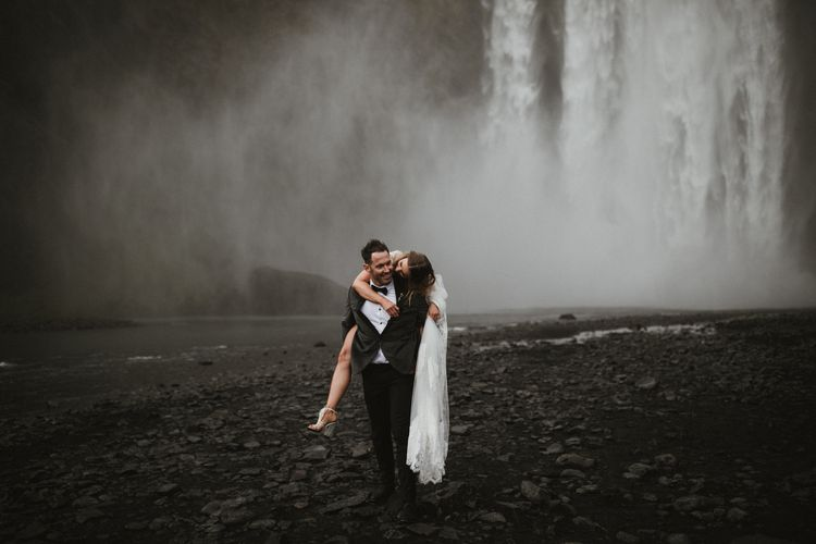 Iceland Elopement With Bride In Cold Shoulder Wedding Dress With Merlot Lips & Nails And Celestial Headpiece With Images From James Frost