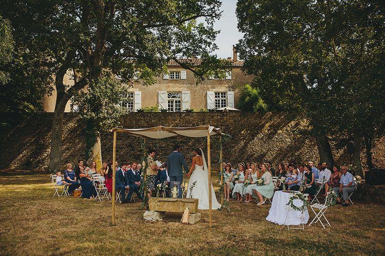 Outdoor Wedding Ceremony | Bride in Jesús Peiró 3000 Dress from Morgan Davies Bridal | Groom in New & Lingwood Three Piece Suit | Petar Jurica Photography