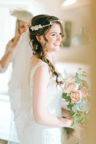 Boho Bride With Braid & Flowers In Her Hair