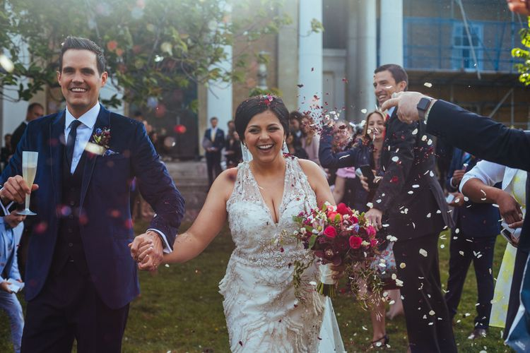 Confetti Moment | Bride in Lazaro Gown | Groom in Navy Ted Baker Suit | Helen Abraham Photography