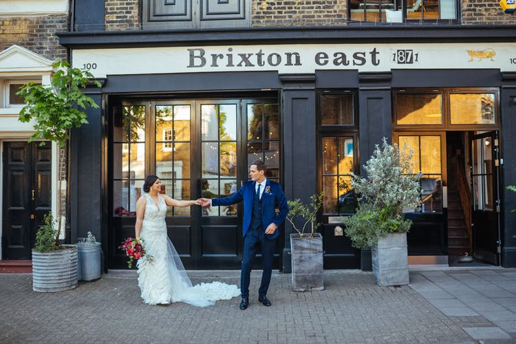Brixton East | Bride in Lazaro Gown | Groom in Navy Ted Baker Suit | Helen Abraham Photography