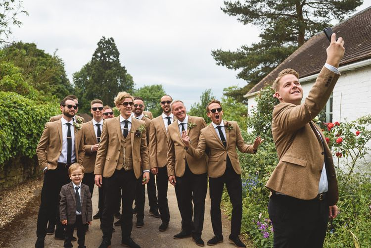 Groomsmen in Navy Trousers & Mustard Wool Jackets | Outdoor Tipi Wedding at The Georgian Rectory Buckingham | Jackson & Co Photography | Blooming Lovely Films