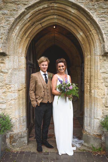 Church Wedding Ceremony | Bride in Charlie Brear Gown | Groom in Navy & Mustard Suit | Outdoor Tipi Wedding at The Georgian Rectory Buckingham | Jackson & Co Photography | Blooming Lovely Films