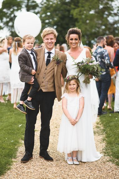 Family Photo | Bride in Charlie Brear Gown | Groom in Navy & Mustard Suit | Outdoor Tipi Wedding at The Georgian Rectory Buckingham | Jackson & Co Photography | Blooming Lovely Films
