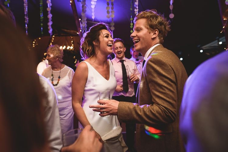 Evening Reception | Bride in Charlie Brear Gown | Groom in Mustard Tweed Jacket | Outdoor Tipi Wedding at The Georgian Rectory Buckingham | Jackson & Co Photography | Blooming Lovely Films