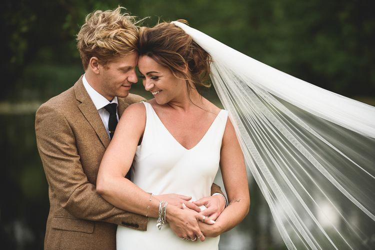Bride in Charlie Brear Gown | Groom in Mustard Tweed Jacket | Outdoor Tipi Wedding at The Georgian Rectory Buckingham | Jackson & Co Photography | Blooming Lovely Films