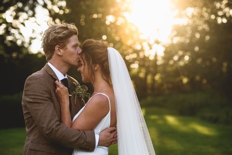 Golden Hour | Bride in Charlie Brear Gown | Groom in Mustard Tweed Jacket | Outdoor Tipi Wedding at The Georgian Rectory Buckingham | Jackson & Co Photography | Blooming Lovely Films
