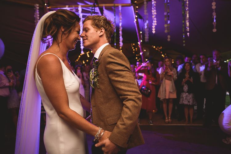 First Dance | Bride in Charlie Brear Gown | Groom in Mustard Tweed Jacket | Outdoor Tipi Wedding at The Georgian Rectory Buckingham | Jackson & Co Photography | Blooming Lovely Films