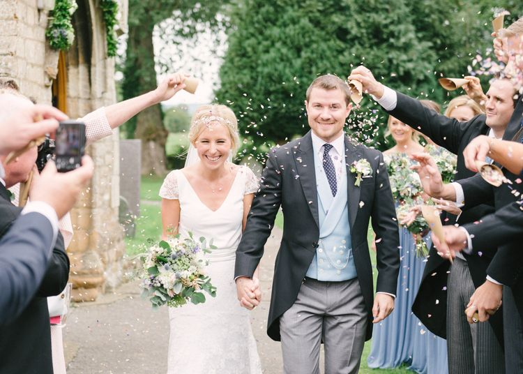Confetti Moment with Bride in Charlie Brear Peyton Dress & Augustine Skirt & Groom in Traditional Tails