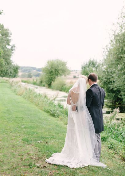 Bride in Charlie Brear Peyton Dress & Augustine Skirt & Groom in Traditional Morning Suit