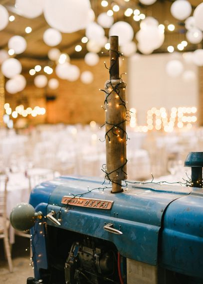 Tractor in Lantern Filled Rustic Barn Reception