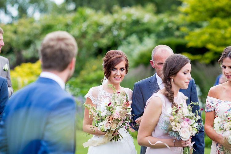 Outdoor Ceremony Bridal Entrance in Raimon Bundo Infanta Wedding Dress