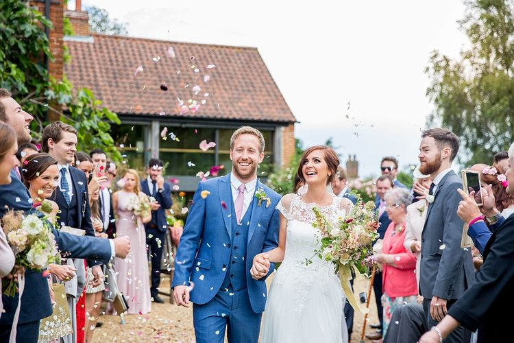 Confetti Shot with Bride in Infanta Wedding Dress & Groom in Blue French Connection Suit