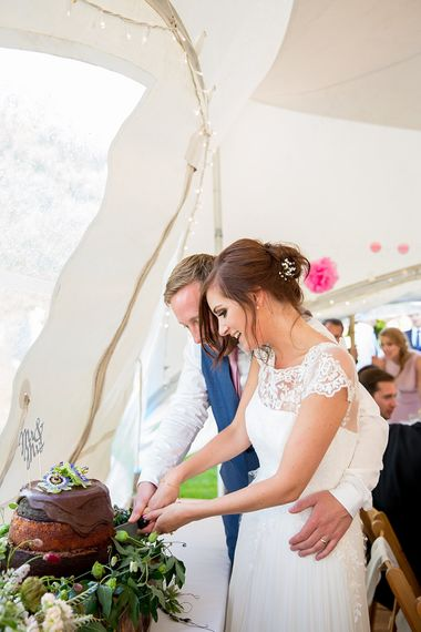 Bride & Groom Cutting the Homemade Chocolate Wedding Cake
