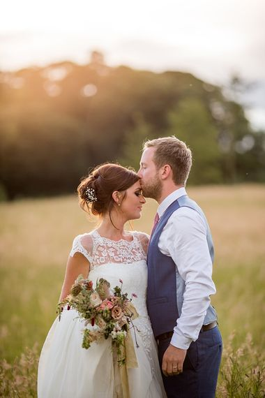 Bride in Raimon Bundo Infanta Wedding Dress & Groom in Blue French Connection Suit