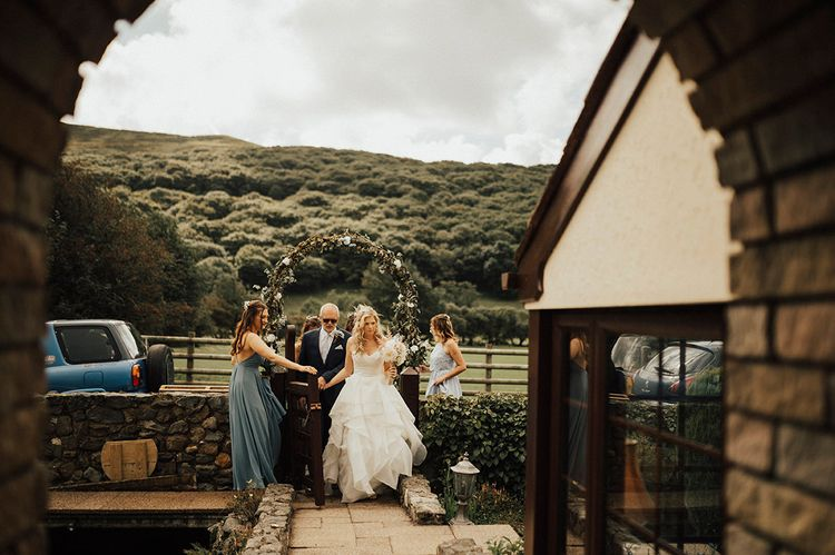 Bridal Entrance in Layered Wedding Dress | Outdoor Festival Beach Wedding at Aberdovey in Wales | Katie Ingram Photography