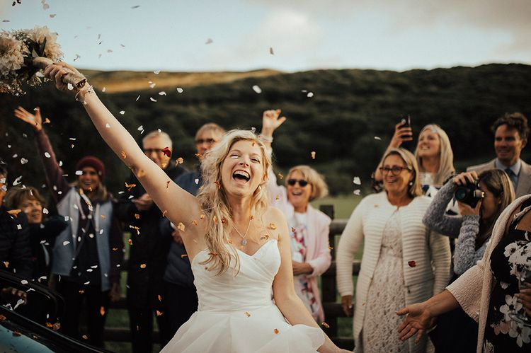 Bride Confetti Moment | Outdoor Festival Beach Wedding at Aberdovey in Wales | Katie Ingram Photography