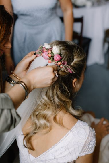 Bridal Half Up Half Down Do with Flowers | Rural Wedding in a Sailcloth Tent on Stanford Hall Estate, Northamptonshire | Rebecca Goddard Photography