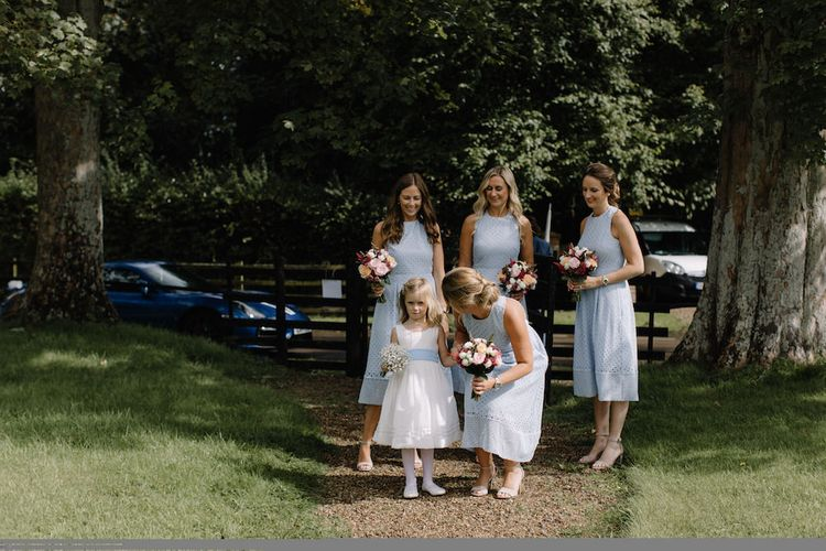 Bridesmaids in Blue Dresses | Rural Wedding in a Sailcloth Tent on Stanford Hall Estate, Northamptonshire | Rebecca Goddard Photography