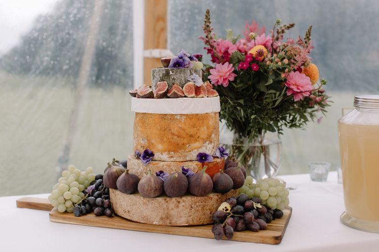 Cheese Tower Wedding Cake | Rural Wedding in a Sailcloth Tent on Stanford Hall Estate, Northamptonshire | Rebecca Goddard Photography
