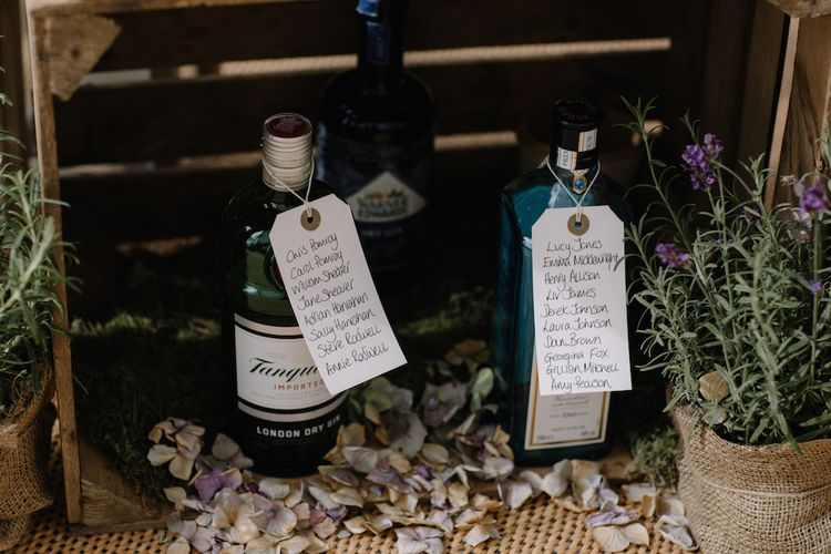 Rustic Wooden Crate & Gin Bottle Table Plan | Rural Wedding in a Sailcloth Tent on Stanford Hall Estate, Northamptonshire | Rebecca Goddard Photography