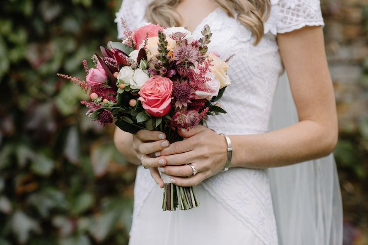 Coral Wedding Bouquet | Bride in a Temperley Cressida Gown | Rural Wedding in a Sailcloth Tent on Stanford Hall Estate, Northamptonshire | Rebecca Goddard Photography