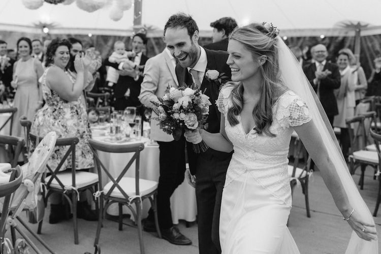 Bride in a Temperley Cressida Gown | Groom in Sandro Suit | Rural Wedding in a Sailcloth Tent on Stanford Hall Estate, Northamptonshire | Rebecca Goddard Photography