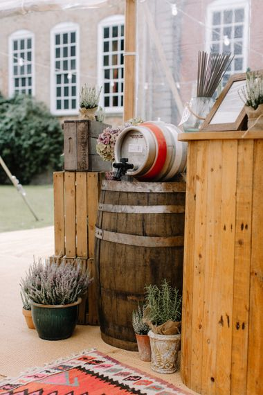 Wooden Beer Barrel | Rural Wedding in a Sailcloth Tent on Stanford Hall Estate, Northamptonshire | Rebecca Goddard Photography