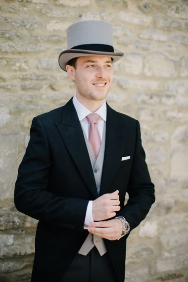 Groom on Top Hat & Tails Morning Suit | Outdoor Pastel Country Garden Wedding at Barnsley House in Cirencester | M and J Photography | Motion Farm Wedding Films