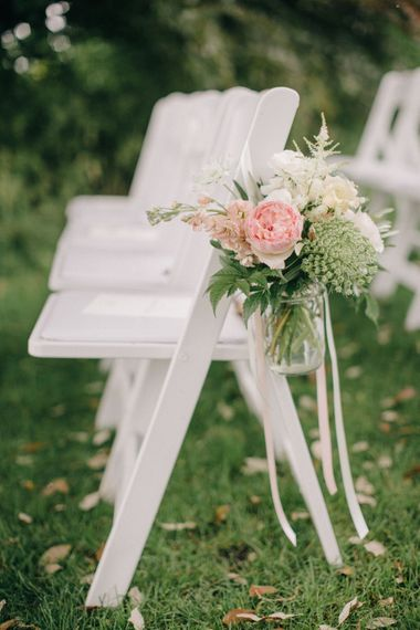 Aisle Chair Wedding Flowers | Outdoor Pastel Country Garden Wedding at Barnsley House in Cirencester | M and J Photography | Motion Farm Wedding Films