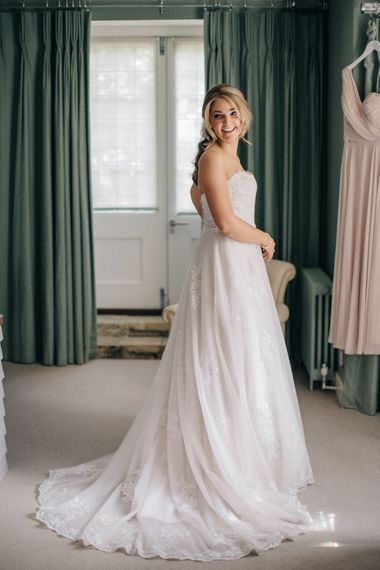 Wedding Morning Bridal Preparations | Bride in Lace Dress | Outdoor Pastel Country Garden Wedding at Barnsley House in Cirencester | M and J Photography | Motion Farm Wedding Films