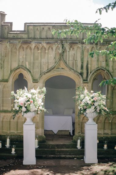 Ceremony Flower Arrangements | Outdoor Pastel Country Garden Wedding at Barnsley House in Cirencester | M and J Photography | Motion Farm Wedding Films