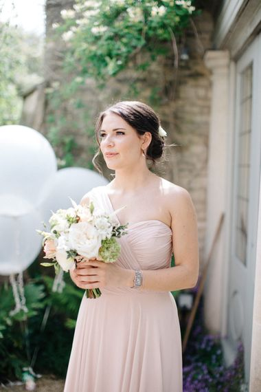 Bridesmaids in Blush Pink One Shoulder Dessy Dress | Outdoor Pastel Country Garden Wedding at Barnsley House in Cirencester | M and J Photography | Motion Farm Wedding Films