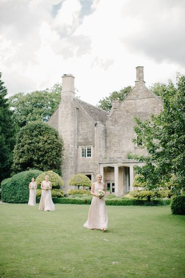 Bridesmaids Entrance in Pink Dessy Dresses | Outdoor Pastel Country Garden Wedding at Barnsley House in Cirencester | M and J Photography | Motion Farm Wedding Films