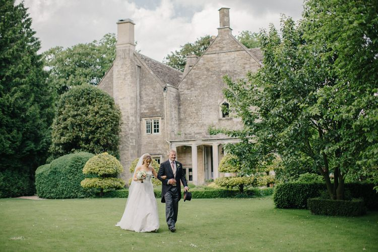 Bridal Entrance in Lace Wedding Dress | Outdoor Pastel Country Garden Wedding at Barnsley House in Cirencester | M and J Photography | Motion Farm Wedding Films