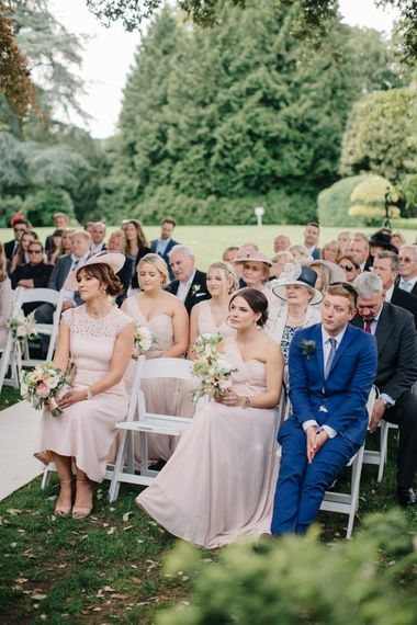 Wedding Guests | Outdoor Pastel Country Garden Wedding at Barnsley House in Cirencester | M and J Photography | Motion Farm Wedding Films