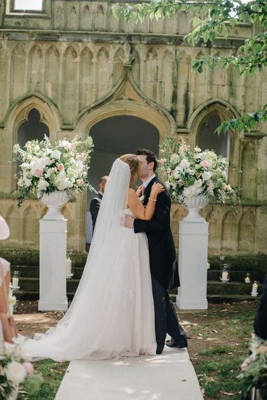 Wedding Ceremony | Bridein Princess Gown | Groom in Top Hat & Tails | Outdoor Pastel Country Garden Wedding at Barnsley House in Cirencester | M and J Photography | Motion Farm Wedding Films