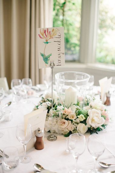 Hurricane Vase, Chuch Candle & Floral Centrepiece | Outdoor Pastel Country Garden Wedding at Barnsley House in Cirencester | M and J Photography | Motion Farm Wedding Films